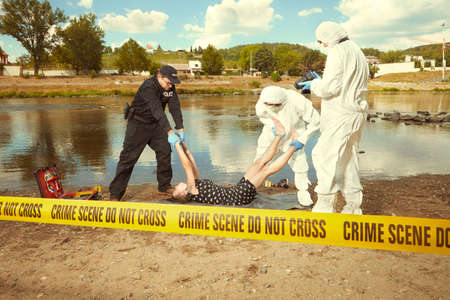 Photo pour Woman body in black apparel found drowned near summer river bank in city - image libre de droit