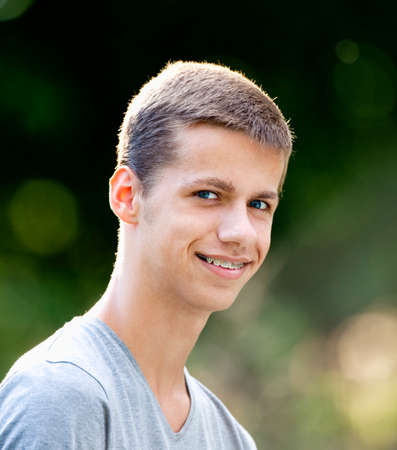 Photo pour Portrait of a Teenage Boy with Braces - image libre de droit