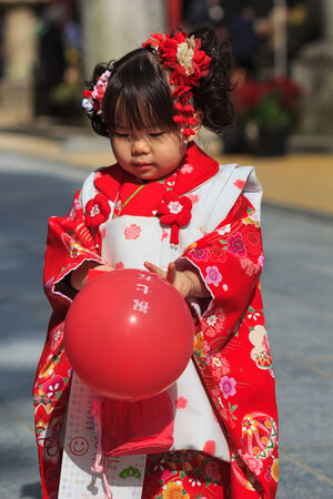 FUKUOKA, JAPAN - NOVEMBER 13  Shichi-go-san in Fukuoka, Japan on November 13, 2013  Traditional rite of passage and festival day in Japan for 3 and 7-year-old girls and 3 and 5-year-old boys