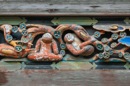 A storehouse with one of the three famous Tosho-gu wood carvings see no evil, speak no evil and hear no evil of the three wise monkeys    NIKKO, JAPAN - NOVEMBER 17, 2015: A storehouse with one of the three famous Tosho-gu wood carvings