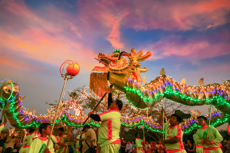 Photo for BANGKOK, THAILAND - FEBUARY 20: A group of people perform a dragon dance during Chinese new year's celebration - Royalty Free Image