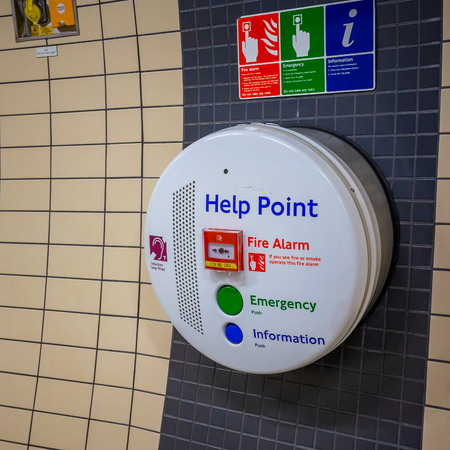 London, UK - May 13 2018: Help point panel for commuters use inside a London underground station