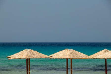 Umbrellas on beach in Milos island