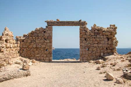 Stone gate overlook to sea, Milos island