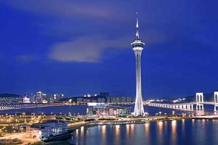 Photo pour Urban landscape of Macau with famous traveling tower under sky near river in Macao, Asia. - image libre de droit