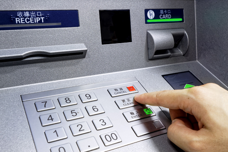 Photo for ATM - entering pin close up - Royalty Free Image