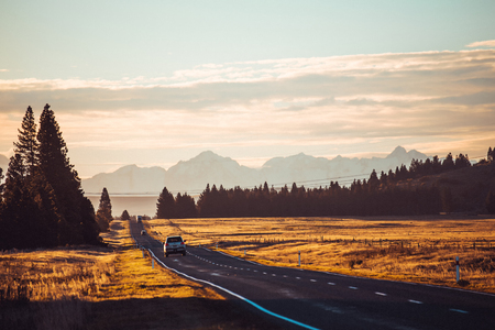 Photo pour Road travel in the green mountains of New Zealand view from car window. Scenic peaks and ridges. Beautiful background of amazing nature. - image libre de droit