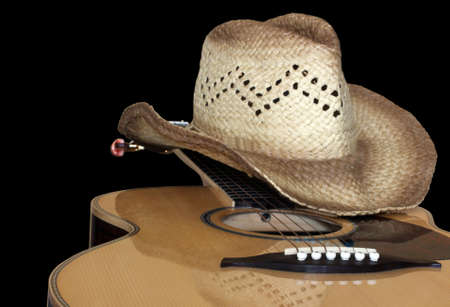 Photo for acoustic guitar with hat isolated on black - Royalty Free Image