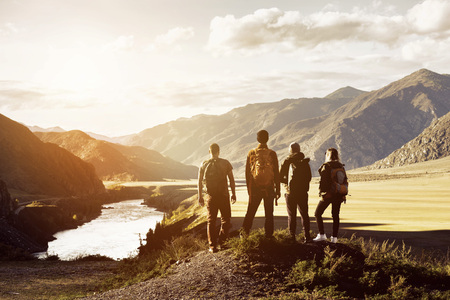 Foto de Group four people mountains travel concept - Imagen libre de derechos