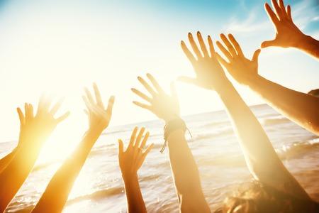 Photo pour Friends travel concept with hands and sunset sea - image libre de droit