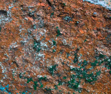 Photo pour Old painted granite stone rock background. In brown, blue, yellow, orange and green colors - image libre de droit