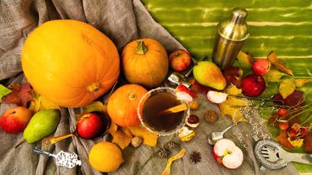 Foto de Flat lay top view autumn fall cocktails season special ingredients. Shaker spoon martini pumpkins and apples, maple leaves. Backdrop banner leaderboard for social media network blogs drink recipe post - Imagen libre de derechos