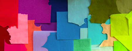 Foto de Variety of felt fabric pieces of different colors. A colorful pattern background for hand-made hobby shop decoration, a horizontal leaderboard for website banner or social network group header design - Imagen libre de derechos