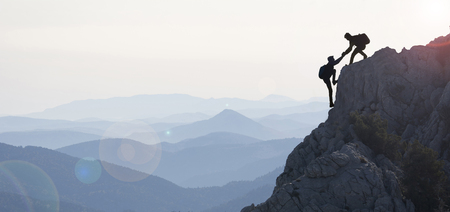 Photo for The concept of cooperation and climbers near the summit - Royalty Free Image
