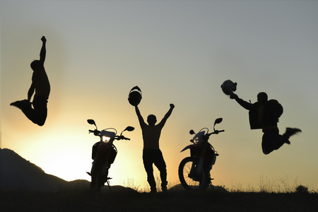 successful and happy motorcyclist on the summit