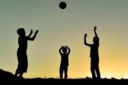 Photo pour a frame describing the pleasant moments of an energetic group of children playing with the ball - image libre de droit