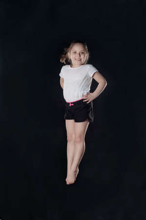 Little caucasian female gymnast