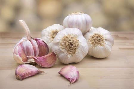 Set of garlic on wooden board with natural background