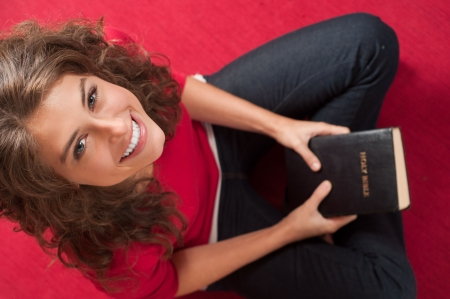 Young girl smiling with Bible