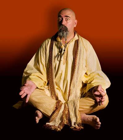 Funny guru sitting lotus style.