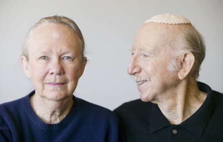 Close-up of elderly Jewish couple in studio.