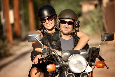 Man and Woman riding on vintage motorcyleの写真素材
