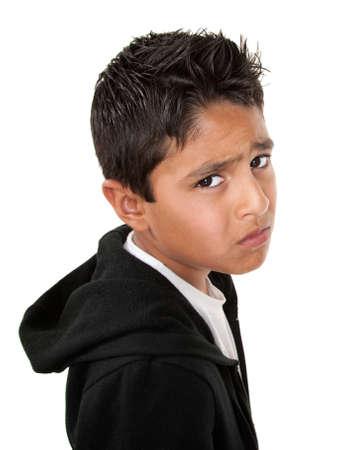 Whiny or sad Hispanic male on white background