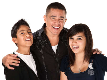 Smiling Hispanic father with happy children on white background