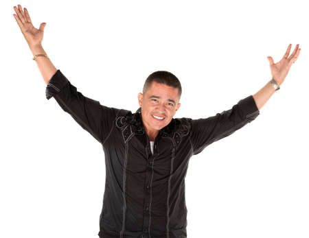 Latino man smiling with raised arms on white background