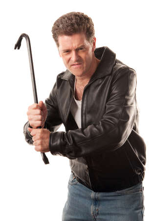 Angry man in leather jacket ready to strike with a crowbar