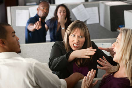 Two female coworkers fight in office cubicle