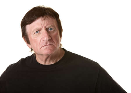 Suspicious mature Caucasian man over white background