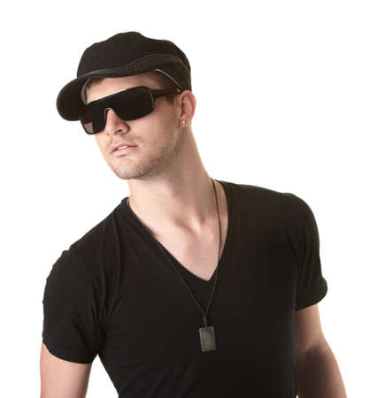 Trendy young Caucasian man with sunglasses over white background