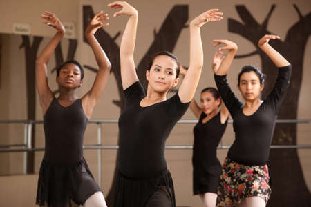 Group of serious ballet dance students performing