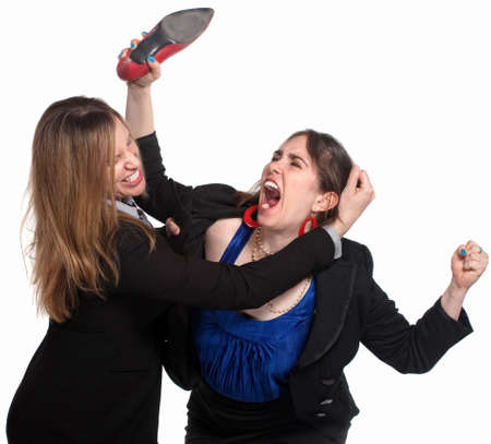 Two professional woman fighting over white background