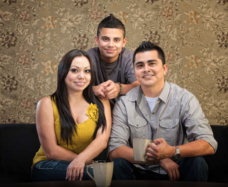 Loving Latino family of three sitting together