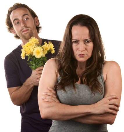 Angry young woman and man with flower bouquet