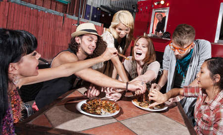 Group of happy people eating out at mobile restaurant