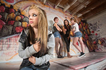 Insecure European teenager being bullied by female gang
