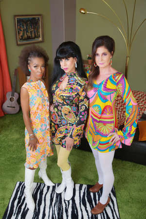 Group of three attractive diverse 1960s women posing