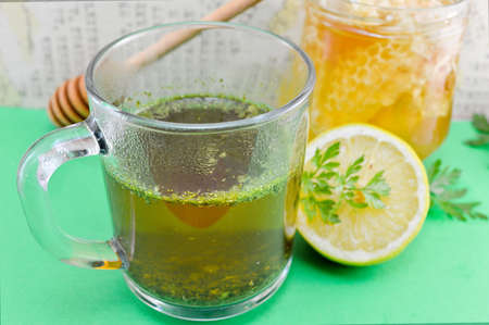 Tea with parsley, lemon and honey. Healthy beverage