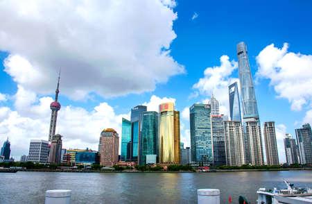 Foto für Shanghai, China - August 8, 2019: Shanghai modern downtown area with skyscrapers in Chinese metropolis view from the Bund - Lizenzfreies Bild