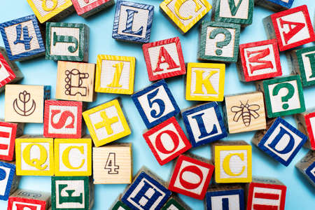 Photo pour Alphabet characters written with wooden letters, education abstract background top view - image libre de droit