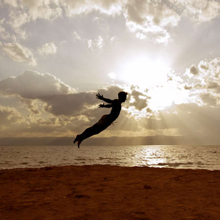 One person acrobatic jumping scene, look like Peter Pan is flying, symbolize vitality, aspiration, success, progress as well as fantasy, imagination, incentive, personal development, power, Agility and much moreScene is performed in front of the dead sea