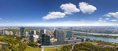 Very clear and detailed panorama of the amazing Skyline of Donau City Vienna with the famous UNO City at the left the Danube at the right and the Donaupark in front The image was made out of several high resolution vertical shots meticulously merged into
