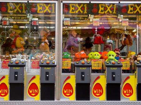 Arcade crane claw machine on an arcade in The Netherlands, Europe