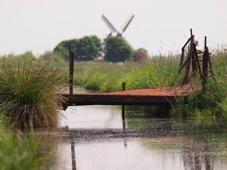 Rusty bridge in rural landscape