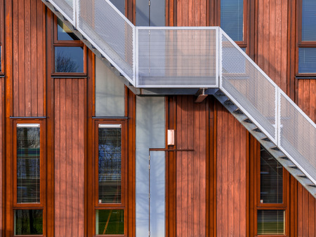 Escape stairs on a sustainable wooden office building background