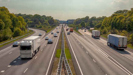 Foto de Right hand side Evening Traffic on the A12 Motorway through the Veluwe forest. One of the Bussiest highways in the Netherlands - Imagen libre de derechos