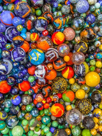 Foto de Background of colorful glass taws as a concept for diversity - Imagen libre de derechos